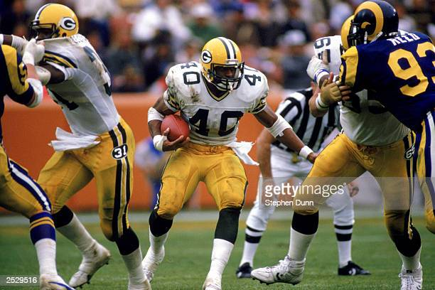 Running back Eddie Lee Ivery of the Green Bay Packers runs through the hole against the Los Angeles Rams durng the 1986 NFL season at Anaheim Stadium...