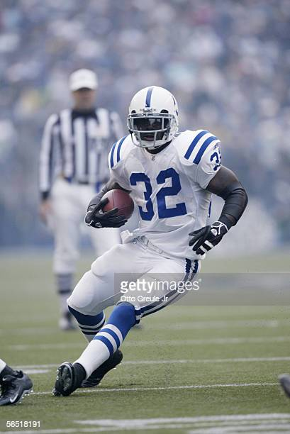Running back Edgerrin James of the Indianapolis Colts carries the ball against the Seattle Seahawks at Qwest Field on December 24 2005 in Seattle...