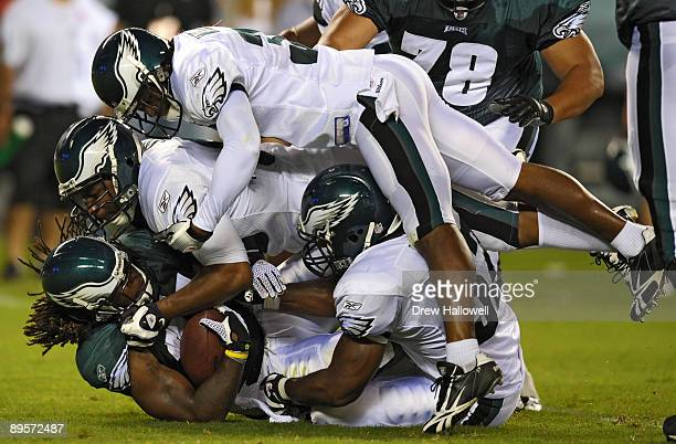 Running back Eldra Buckley of the Philadelphia Eagles gets gang tackled by the defense during training camp on August 2, 2009 at Lincoln Financial...
