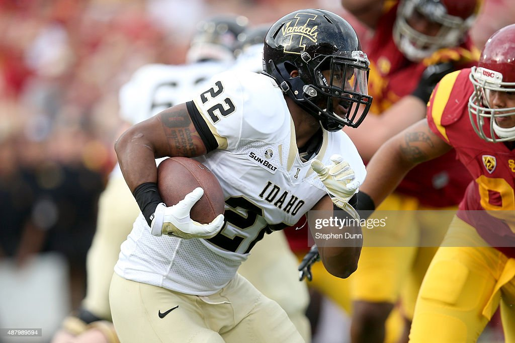 Running back Elijhaa Penny #22 of the Idaho Vandals carries the ball against the USC Trojans at Los Angeles Memorial Coliseum on September 12, 2015 in Los Angeles, California.