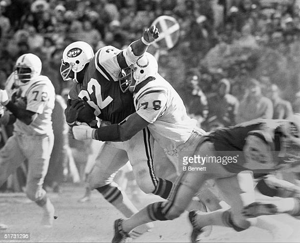Running back Emerson Boozer of the New York Jets gets tackled from by a Baltimore Colts defensive player during a game circa 19661975