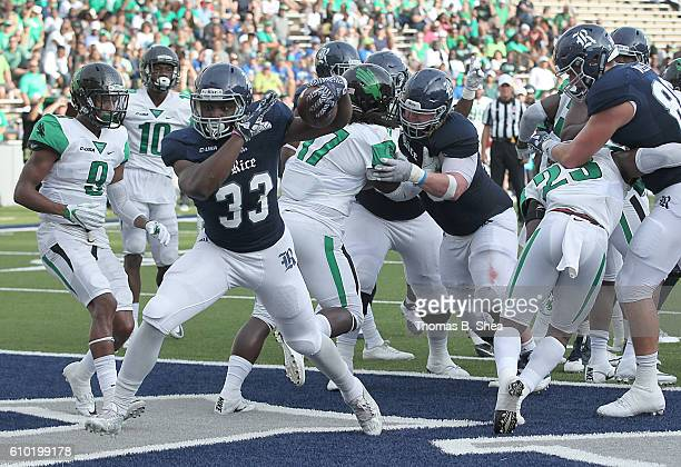 Running back Emmanuel Esukpa of the Rice Owls rushes for a touchdown against the North Texas Mean Green defense in the first half at Rice Stadium on...