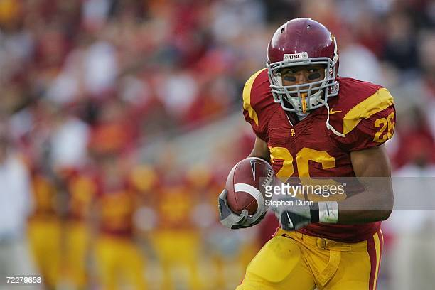 Running back Emmanuel Moody of the USC Trojans carries the ball against the Arizona State Sun Devils at the Los Angeles Memorial Coliseum on October...