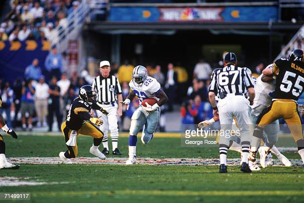 Running back Emmitt Smith of the Dallas Cowboys battles for yards during Super Bowl XXX against the Pittsburgh Steelers at Sun Devil Stadium on...