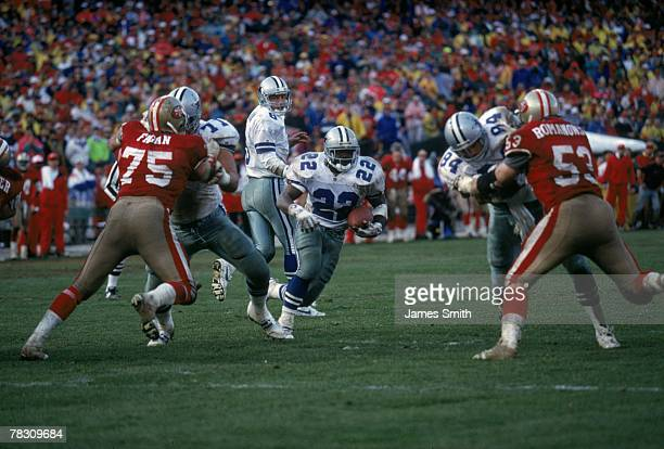 Running back Emmitt Smith of the Dallas Cowboys runs against the San Francisco 49ers in the 1992 NFC Championship Game at Candlestick Park on January...