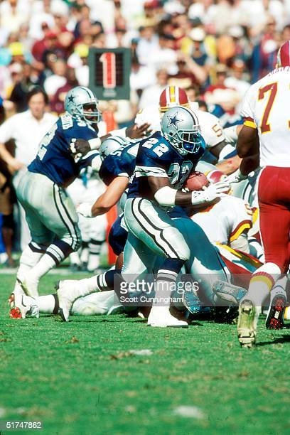 Running back Emmitt Smith of the Dallas Cowboys runs for daylight in a 15 to 19 loss to the Washington Redskins on September 23 1990