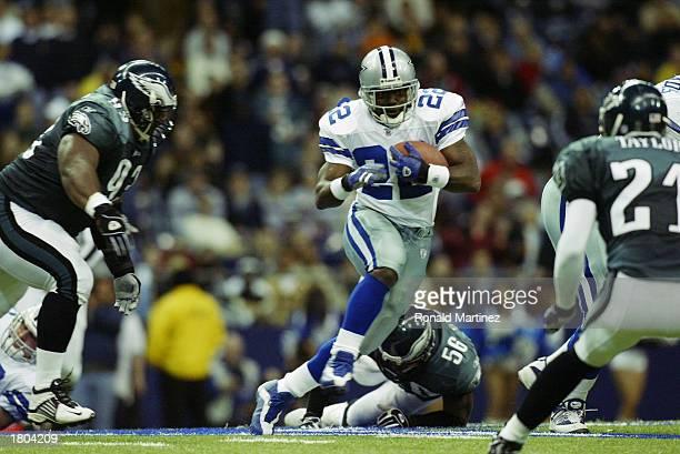 Running back Emmitt Smith of the Dallas Cowboys runs the ball against the Philadelphia Eagles at Texas Stadium on December 21 2002 in Irving Texas...