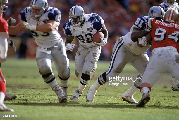 Running back Emmitt Smith of the Dallas Cowboys rushes for yards against the San Francisco 49ers defense during the 1994 NFC Conference Championship...