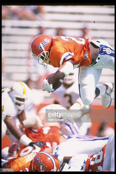 Running back Emmitt Smith of the Florida Gators jumps over the pile during a game against the Vanderbilt Commadores at Florida Field in Gainesville,...