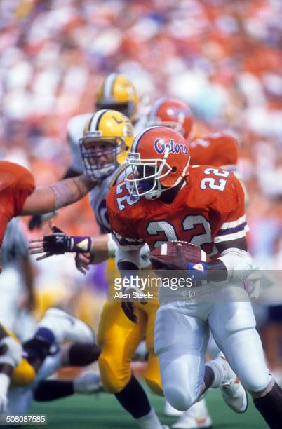 Running back Emmitt Smith of the Florida Gators runs down the field during a game against the LSU Tigers on October 1 1988 at Ben Hill Griffin...