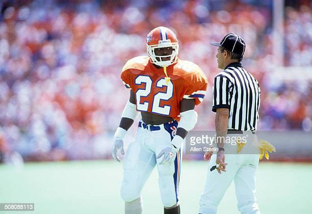 Running back Emmitt Smith of the Florida Gators talks with the referee during a game against the Ole Miss Rebels at Ben Hill Griffin Stadium on...