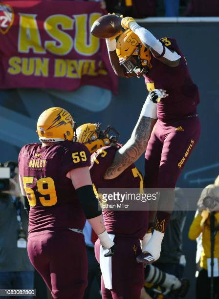 Running back Eno Benjamin and offensive lineman Cohl Cabral of the Arizona State Sun Devils celebrate after Benjamin ran for a touchdown against the...
