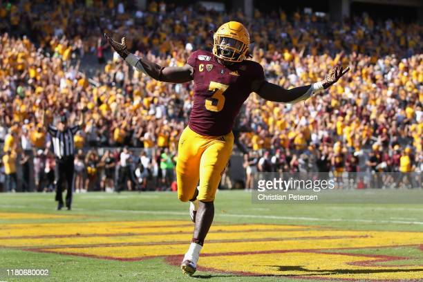 Running back Eno Benjamin of the Arizona State Sun Devils celebrates after scoring on a 32 rushing touchdown against the Washington State Cougars...