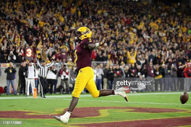 Running back Eno Benjamin of the Arizona State Sun Devils scores on a one yard rushing touchdown against the Arizona Wildcats during the second half...
