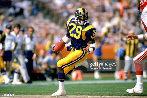 Running back Eric Dickerson of the Los Angeles Rams carries the ball against the Atlanta Falcons at Anaheim Stadium on October 26 1986 in Anaheim...