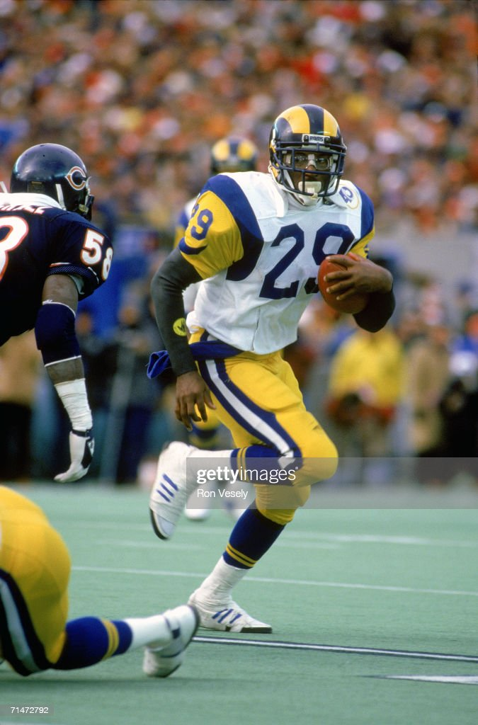 Running back Eric Dickerson #29 of the Los Angeles Rams evades the Chicago Bears during a game at Soldier Field in Chicago, Illinois.