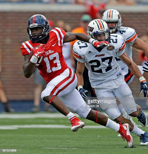 Running back Eugene Brazley of the Mississippi Rebels breaks free for a touchdown during the second half of a NCAA college football game against the...