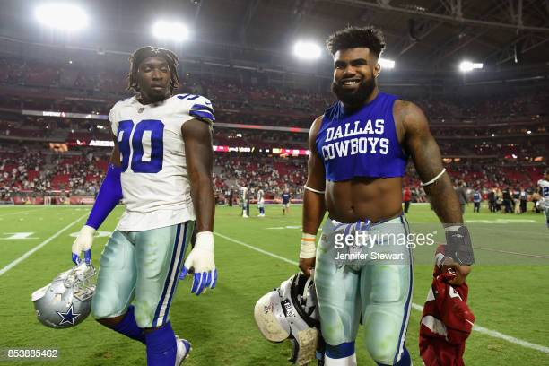 Running back Ezekiel Elliott of the Dallas Cowboys and defensive end Demarcus Lawrence walk off the field after the NFL game against the Arizona...
