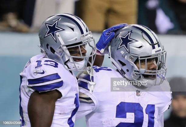 Running back Ezekiel Elliott of the Dallas Cowboys celebrates his touchdown with teammate wide receiver Michael Gallup against the Philadelphia...