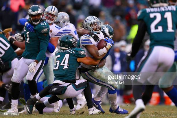Running back Ezekiel Elliott of the Dallas Cowboys runs for a first down against linebacker Dannell Ellerbe and outside linebacker Kamu GrugierHill...