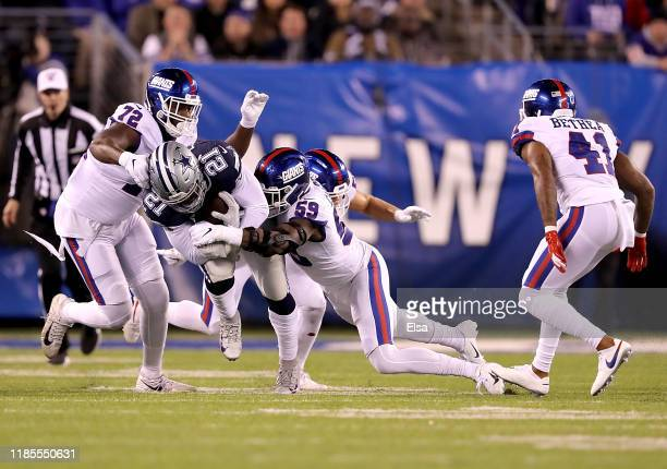 Running back Ezekiel Elliott of the Dallas Cowboys rushes against the defense of the New York Giants during the game at MetLife Stadium on November...
