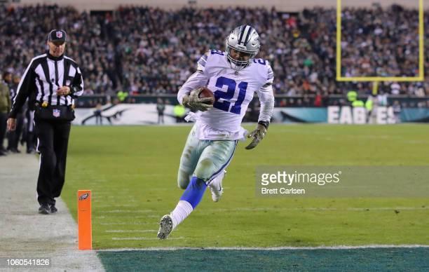 Running back Ezekiel Elliott of the Dallas Cowboys scores a touchdown against the Philadelphia Eagles in the fourth quarter during the fourth quarter...