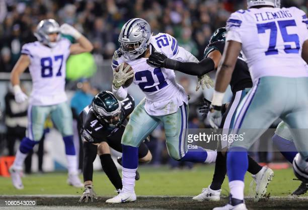 Running back Ezekiel Elliott of the Dallas Cowboys scores a touchdown against linebacker Nate Gerry of the Philadelphia Eagles during the fourth...