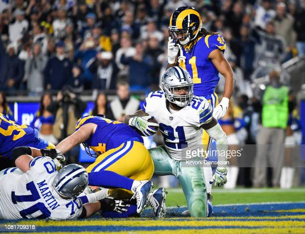 Running back Ezekiel Elliott of the Dallas Cowboys scores a touchdown in the third quarter against the Los Angeles Rams in the NFC Divisional Round...