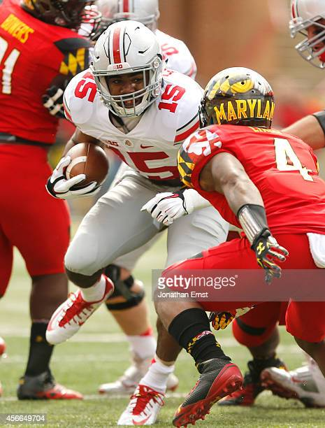Running back Ezekiel Elliott of the Ohio State Buckeyes carries the ball against the Maryland Terrapins during Ohio State's 5224 win at Byrd Stadium...