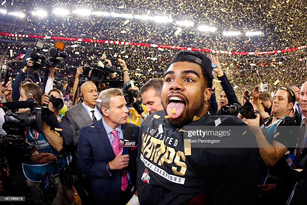 Running back Ezekiel Elliott #15 of the Ohio State Buckeyes celebrates after defeating the Oregon Ducks 42 to 20 in the College Football Playoff National Championship Game at AT&T Stadium on January 12, 2015 in Arlington, Texas.