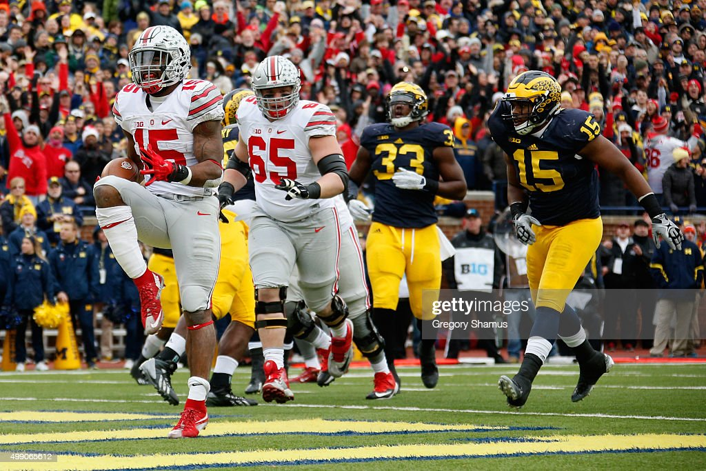 Running back Ezekiel Elliott #15 of the Ohio State Buckeyes celebrates after rushing for a second quarter touchdown against the Michigan Wolverines at Michigan Stadium on November 28, 2015 in Ann Arbor, Michigan.