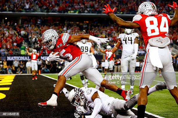 Running back Ezekiel Elliott of the Ohio State Buckeyes scores a 9 yard touchdown in the third quarter against the Oregon Ducks during the College...