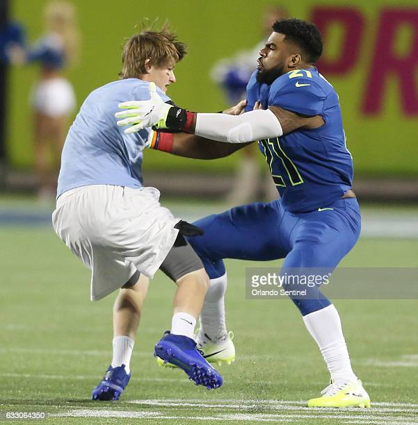 NFC running back Ezekiel Elliott tackles a fan who ran onto the field during the NFL Pro Bowl on Sunday Jan 29 2017 at Camping World Stadium in...