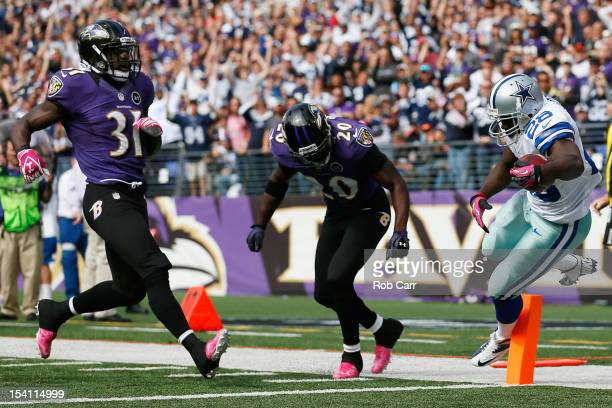 Running back Felix Jones of the Dallas Cowboys scores a touchdown in front of Bernard Pollard and Ed Reed of the Baltimore Ravens during the first...