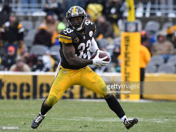 Running back Fitzgerald Toussaint of the Pittsburgh Steelers carries the ball downfield in the fourth quarter of a game on December 31 2017 against...