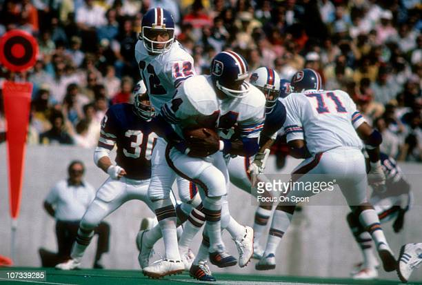 Running back Floyd Little of the Denver Broncos carries the ball against the Buffalo Bills during an NFL football game at Rich Stadium October 5 1975...