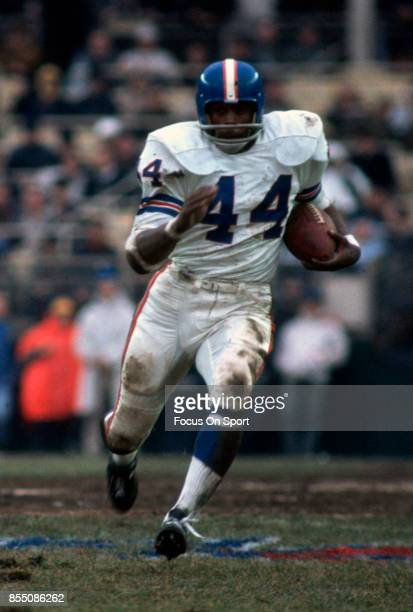 Running back Floyd Little of the Denver Broncos carries the ball against the New York Jets during an NFL football game at Shea Stadium circa 1967 in...