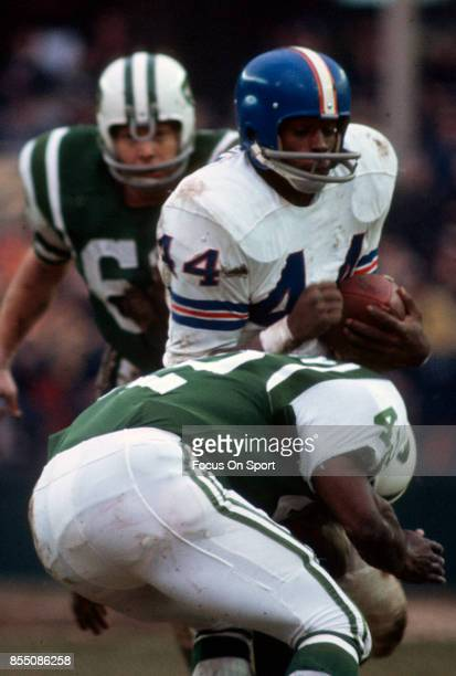 Running back Floyd Little of the Denver Broncos gets tackled by Randy Beverley of the New York Jets during an NFL football game at Shea Stadium circa...