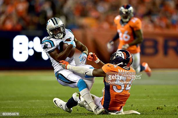 Running back Fozzy Whittaker of the Carolina Panthers is tackled by inside linebacker Brandon Marshall of the Denver Broncos in the first half at...