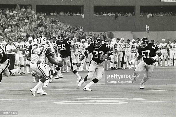 Running back Franco Harris of the Pittsburgh Steelers runs against the New York Jets with blocking help from offensive linemen Ray Mansfield and Sam...