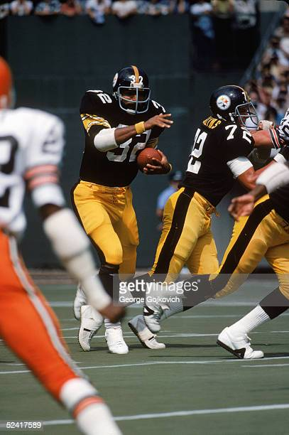 Running back Franco Harris of the Pittsburgh Steelers runs behind the blocking of guard Gerry Mullins during an NFL game against the Cleveland Browns...
