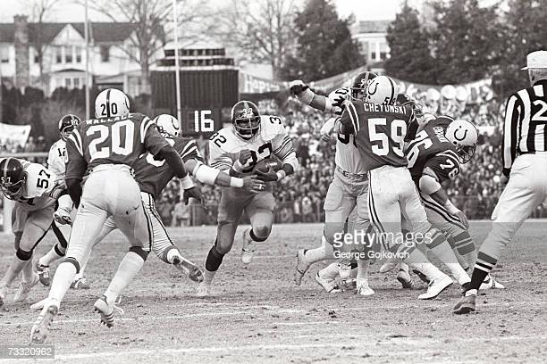 Running back Franco Harris of the Pittsburgh Steelers runs the football against the Baltimore Colts during a playoff game at Memorial Stadium on...