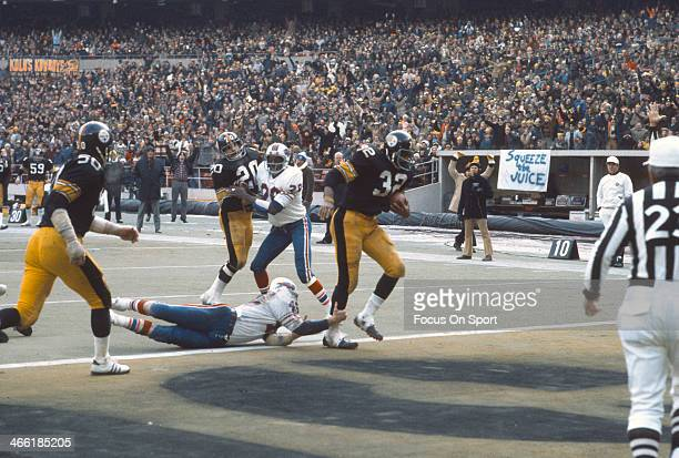 Running back Franco Harris of the Pittsburgh Steelers scores a touchdown against the Buffalo Bills during the AFC Divisional Playoffs December 22...