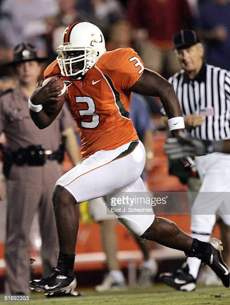 Running back Frank Gore of the Miami Hurricanes heads into the end zone for a touchdown against the Clemson Tigers in the first half on November 6...