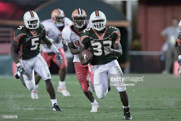 Running back Frank Gore of the Miami Hurricanes runs with the ball during the Big East Conference football game against the Syracuse Orangemen at the...