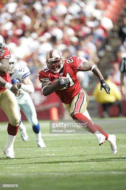 Running back Frank Gore of the San Francisco 49ers runs with the ball against the Dallas Cowboys during the game at Monster Park on September 25 2005...