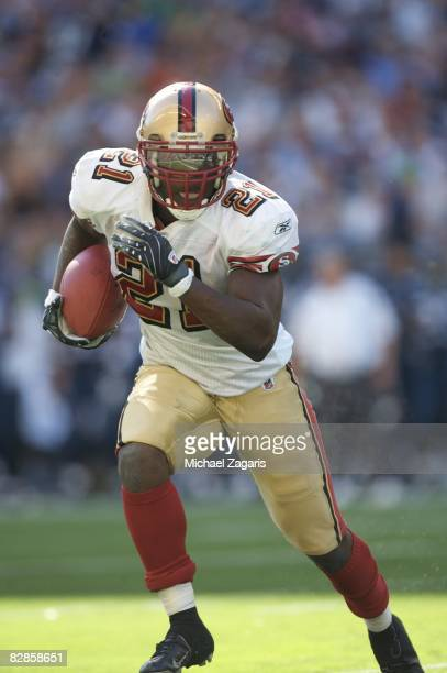 Running back Frank Gore of the San Francisco 49ers runs with the ball during an NFL game against the Seattle Seahawks on September 14 2008 at Qwest...