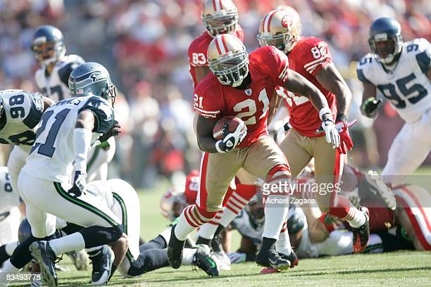 Running back Frank Gore of the San Francisco 49ers runs with the ball during the NFL game against the Seattle Seahawks on Bill Walsh Field at...