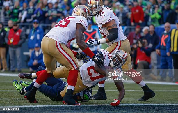 Running back Frank Gore of the San Francisco 49ers rushes for a touchdown against the Seattle Seahawks at CenturyLink Field on December 14 2014 in...