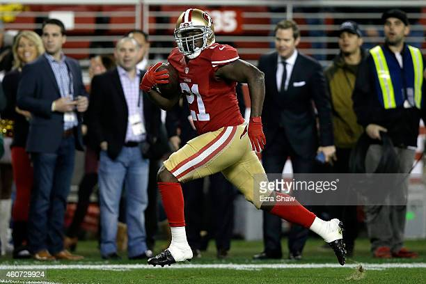Running back Frank Gore of the San Francisco 49ers scores on a 52yard touchdown run in the first quarter against the San Diego Chargers at Levi's...